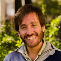 Frederico Toldeo has brown hair and is smiling. He is a well known Quality Engineer and co-founded of Abstracta.