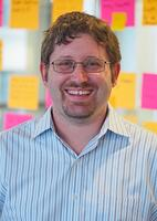 Geoff Cooney has brown hair and is wearing glasses and blue, striped shirt. He is a software engineer at mabl.