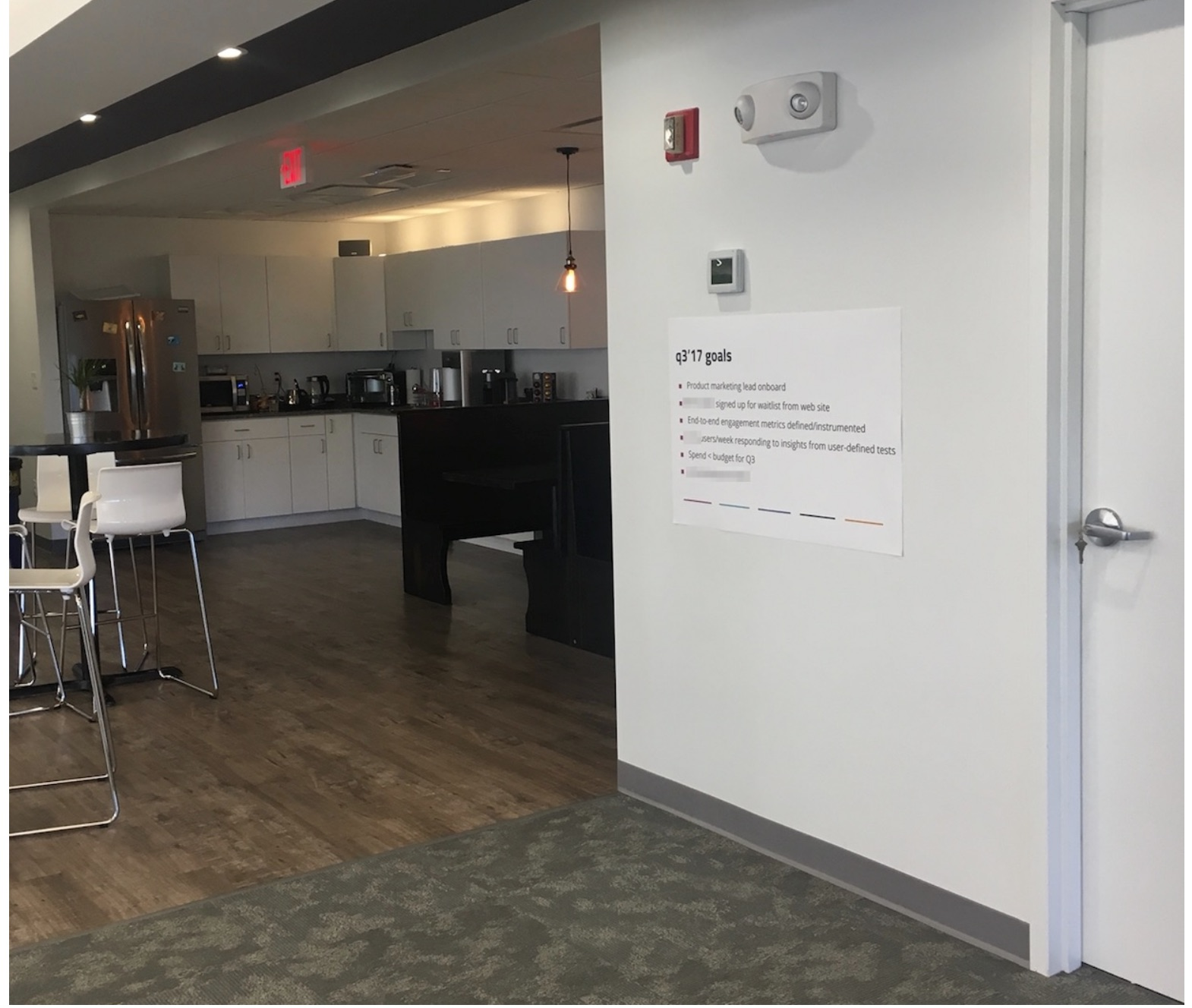 A kitchen and eating area in an office building.